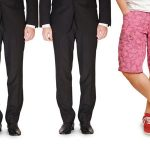 Five men wearing pants, one wearing shorts