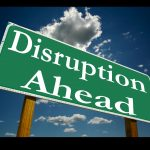 Sign that reads disruption ahead
